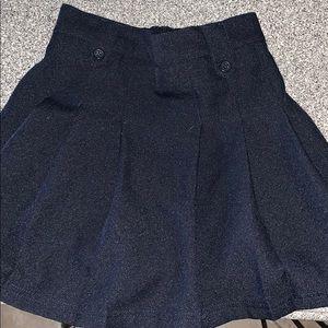 Three uniform items.  Shorts skirt and skort.